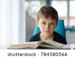 tired 8 years old boy doing his ...   Shutterstock . vector #784580566
