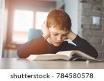 child reading a book at the... | Shutterstock . vector #784580578