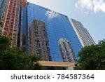 skyscrapers mirrored in the... | Shutterstock . vector #784587364