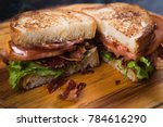 blt sandwich with fried bacon ... | Shutterstock . vector #784616290