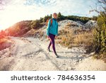 a girl with a backpack walks... | Shutterstock . vector #784636354