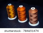 three bright spools of silk... | Shutterstock . vector #784651474