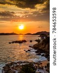 Small photo of Colorful sunset over Acapulco bay.CR2