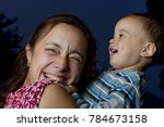 baby pulls his mom's hair | Shutterstock . vector #784673158