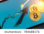 Small photo of bitcoin. Bitcoin cryptocurrency chart on tablet pc with arrow pointing up. Increasing value and financial upswing concept. Success and gains in crypto bitcoin investments. Copyspace for text.