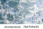 aerial view of waves at beach... | Shutterstock . vector #784709650