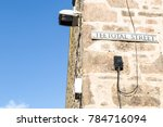 Small photo of Teetotal Street sign on Cornish granite stone wall in St Ives Cornwall.