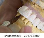 technician dental is working... | Shutterstock . vector #784716289