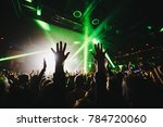 silhouettes of concert crowd in ... | Shutterstock . vector #784720060