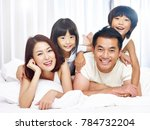 happy asian family with two... | Shutterstock . vector #784732204