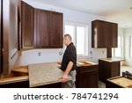 contractor installing a new... | Shutterstock . vector #784741294