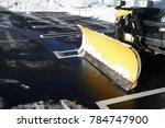 snowplow in the parking lots... | Shutterstock . vector #784747900