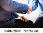businessman shaking hands to... | Shutterstock . vector #784759906
