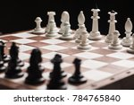 white and black chess pieces on ... | Shutterstock . vector #784765840