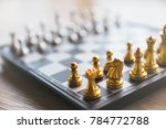 gold and silver chessmen on... | Shutterstock . vector #784772788