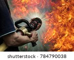 firefighters are using a fire... | Shutterstock . vector #784790038
