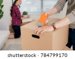 happy young couple moving into... | Shutterstock . vector #784799170