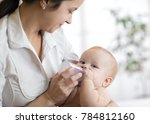 mother gives to drink water... | Shutterstock . vector #784812160