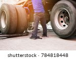 worker man repairing a wheels... | Shutterstock . vector #784818448