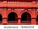striking red facade of an old... | Shutterstock . vector #784834534