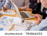 business hand pointing at... | Shutterstock . vector #784866433