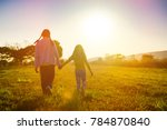two sisters running on the lawn ...   Shutterstock . vector #784870840