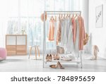 collection of clothes hanging... | Shutterstock . vector #784895659