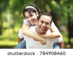 happy young couple together... | Shutterstock . vector #784908460