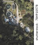 Small photo of drone view of abounded factory in the middle of the forest