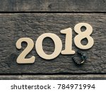 new year 2018 with a horse shoe ... | Shutterstock . vector #784971994