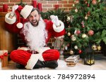 santa claus with gifts sitting... | Shutterstock . vector #784972894