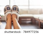 slippers on women's legs. soft... | Shutterstock . vector #784977256