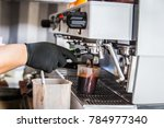 barista making coffee by coffee ... | Shutterstock . vector #784977340