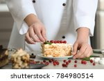 chef decorating piece of tasty...   Shutterstock . vector #784980514
