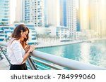 woman using mobile phone on a... | Shutterstock . vector #784999060