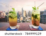 mojito cocktail on table in... | Shutterstock . vector #784999129