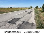 damaged road surface with... | Shutterstock . vector #785010280