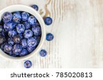 juicy blueberries in a small... | Shutterstock . vector #785020813