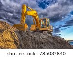 a stopping yellow excavator at...