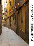 Narrow Street With Hanging...