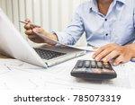 business man using calculator... | Shutterstock . vector #785073319