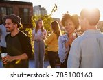happy friends at a rooftop... | Shutterstock . vector #785100163