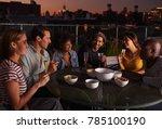 adult friends talking around a... | Shutterstock . vector #785100190