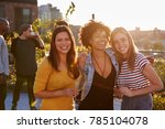 female friends at a rooftop... | Shutterstock . vector #785104078