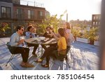 five friends sitting at a table ... | Shutterstock . vector #785106454