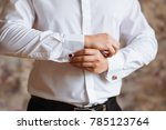 man fastens the buttons on his... | Shutterstock . vector #785123764