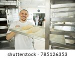 happy baker smiling to the... | Shutterstock . vector #785126353