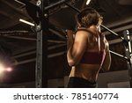 rearview shot of an athletic... | Shutterstock . vector #785140774
