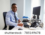 young black man smiling to... | Shutterstock . vector #785149678