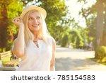 gorgeous mature woman enjoying... | Shutterstock . vector #785154583